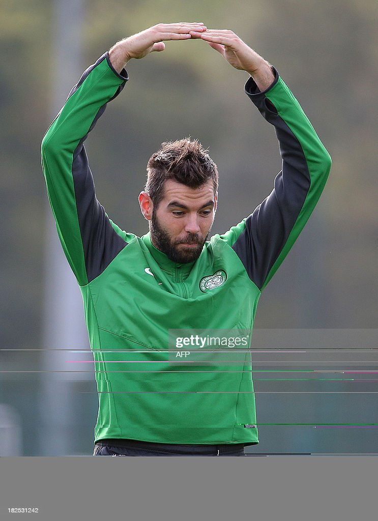 Celtic's Welsh midfielder Joe Ledley gestures during a training session at Lennoxtown Training facility, near Glasgow, Scotland, on September 30, 2013 ahead of their UEFA Champions League last sixteen football match against Barcelona on October 1, 2013.
