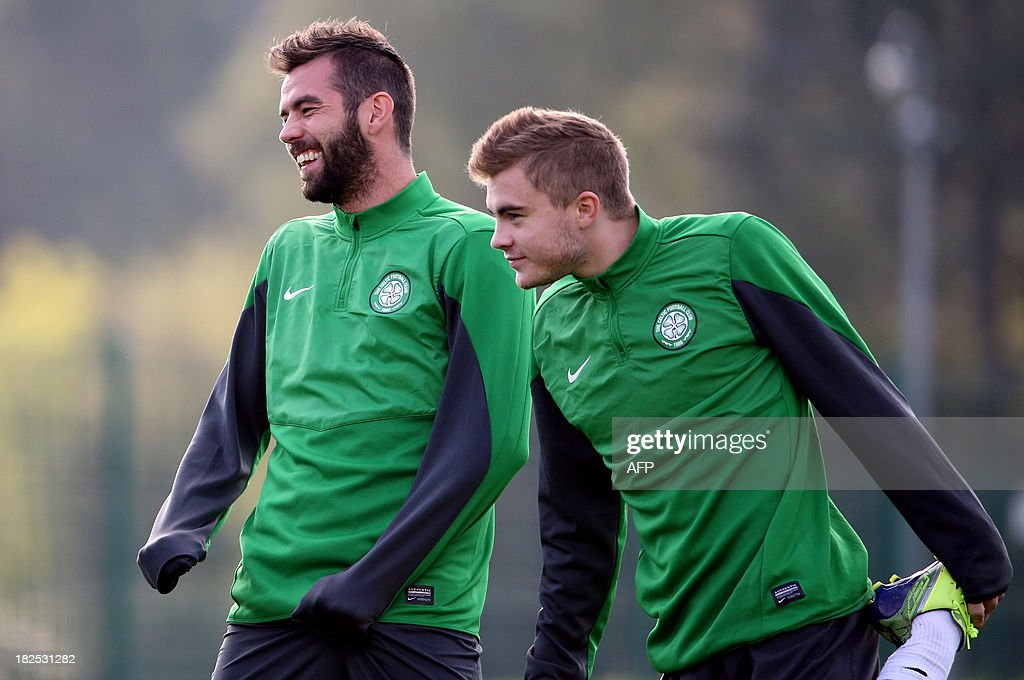 Celtic's Welsh midfielder Joe Ledley (L) gestures during a training session at Lennoxtown Training facility, near Glasgow, Scotland, on September 30, 2013 ahead of their UEFA Champions League last sixteen football match against Barcelona on October 1, 2013.