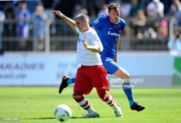Cem Islamoglu of Darmstadt battles for the ball with Tobias Schweinsteiger of Regensburg during the Theard League match between SV Darmstadt 98 and...