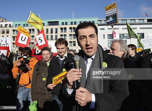 Cem Oezdemir chairman of the Greens party speaks during a protest to the Stuttgart 21 railway station at Berlin main station on October 26 2010 in...
