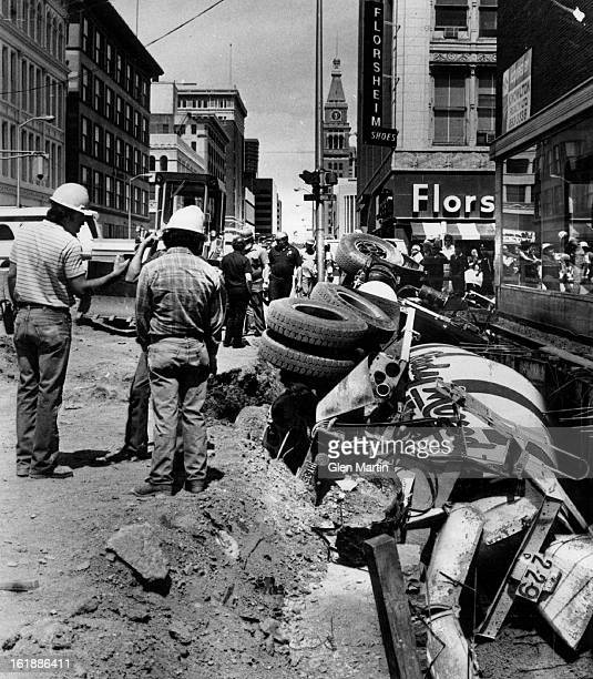 MAY 22 1981 MAY 23 1981 Cement mixer in a ' hole ' lot of trouble Downtown workers got an extra thrill for their lunch breaks Friday when this loaded...