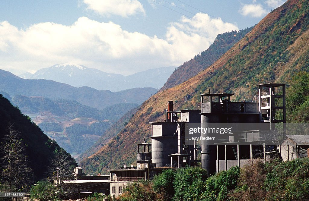 A cement plant sits in a valley near Liuku in Yunnan Province. .