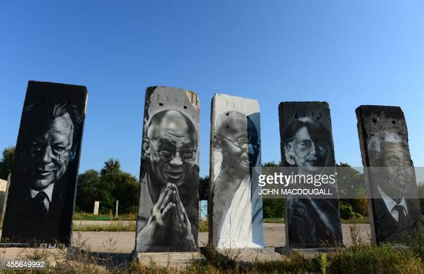 Cement slabs that used to make up the Berlin wall are painted with the portraits of German politician Willy Brandt Tibet's exiled spiritual leader...
