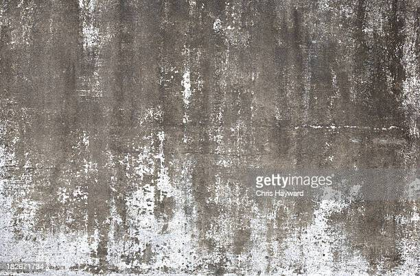 A cement wall that is weathered away