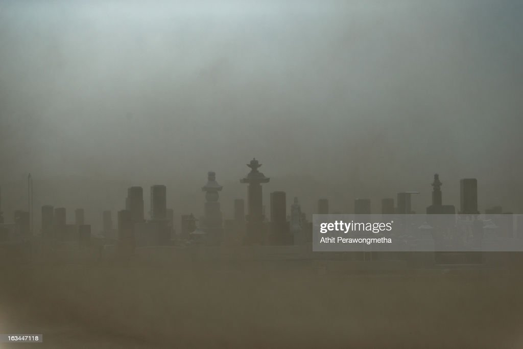 A cemetery has low visibility in heavy windy about 20 km away from Fukushima Nuclear Power Plant prior to the second anniversary commemoration of the...