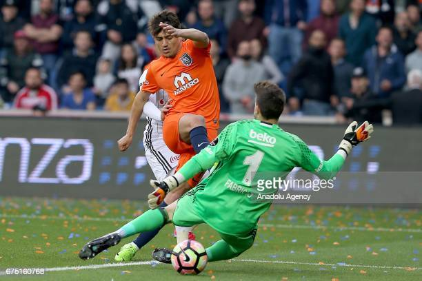 Cengiz Under of Medipol Basaksehir in action against Fabricio Agosto Ramirez of Besiktas during the Turkish Spor Toto Super Lig soccer match between...