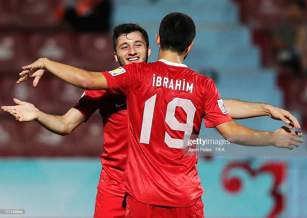 Cenk Sahin (L) of Turkey celebrates with his team mate Ibrahim Yilmaz after scoring his team's third goal during the FIFA U-20 World Cup Group C match between Turkey and El Salvador at Huseyin Avni Aker Stadium on June 22, 2013 in Trabzon, Turkey.