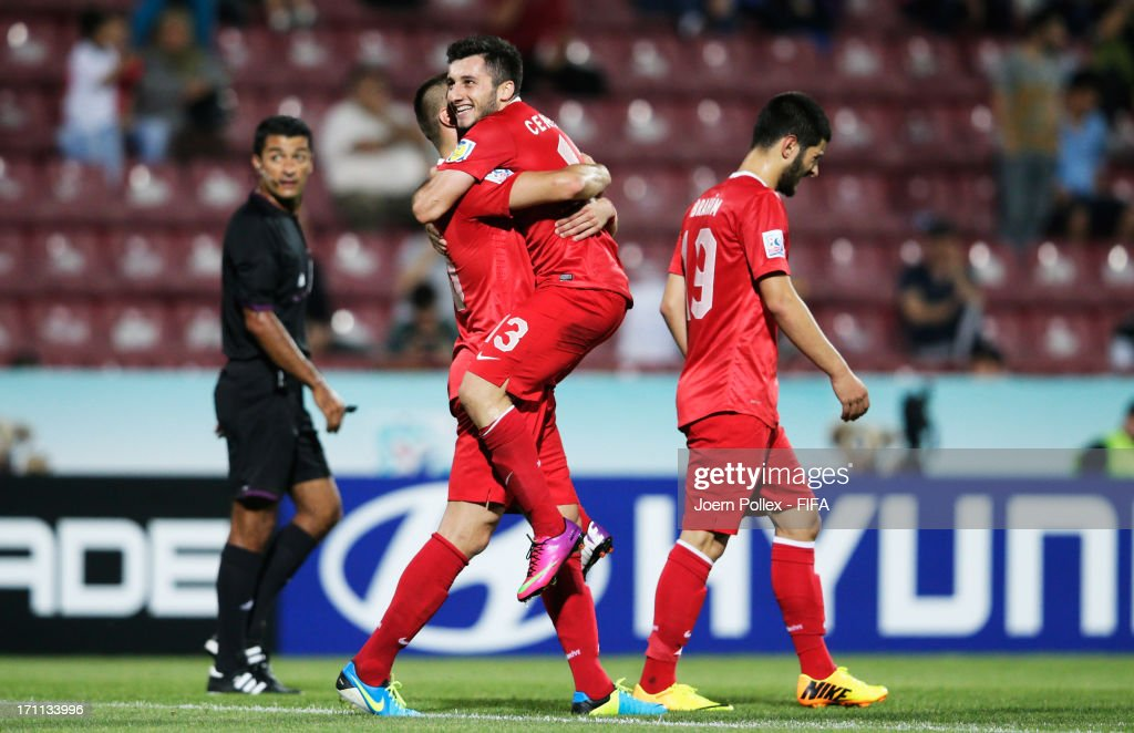Cenk Sahin (C) of Turkey celebrates with his team mate Ibrahim Yilmaz after scoring his team's third goal during the FIFA U-20 World Cup Group C match between Turkey and El Salvador at Huseyin Avni Aker Stadium on June 22, 2013 in Trabzon, Turkey.