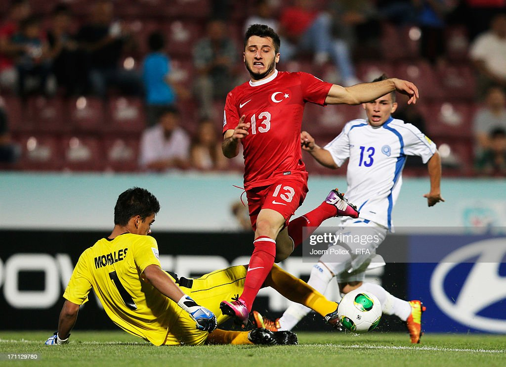 Cenk Sahin (C) of Turkey scores his team's second goal during the FIFA U-20 World Cup Group C match between Turkey and El Salvador at Huseyin Avni Aker Stadium on June 22, 2013 in Trabzon, Turkey.
