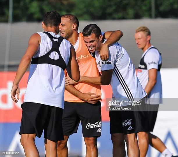 Cenk Tosun and Pepe of Besiktas attend a training session ahead of Turkcell Super Cup between Besiktas and Atiker Konyaspor at Nevzat Demir Sports...