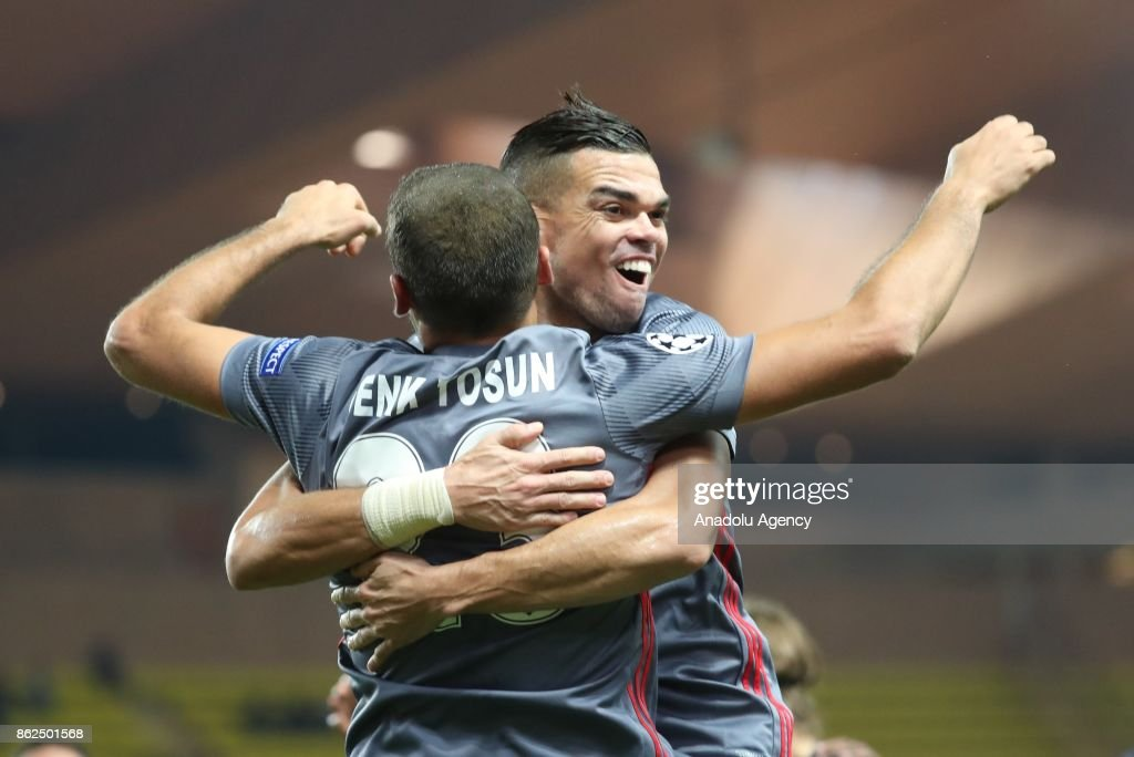 Cenk Tosun (L) of Besiktas celebrates his score with his teammate Pepe during UEFA Champions League Group G match between Monaco and Besiktas at Stade Louis II in Fontvieille, Monaco on October 17, 2017.