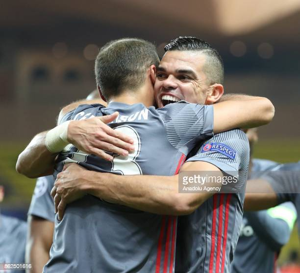 Cenk Tosun of Besiktas celebrates his score with his teammate Pepe during UEFA Champions League Group G match between Monaco and Besiktas at Stade...