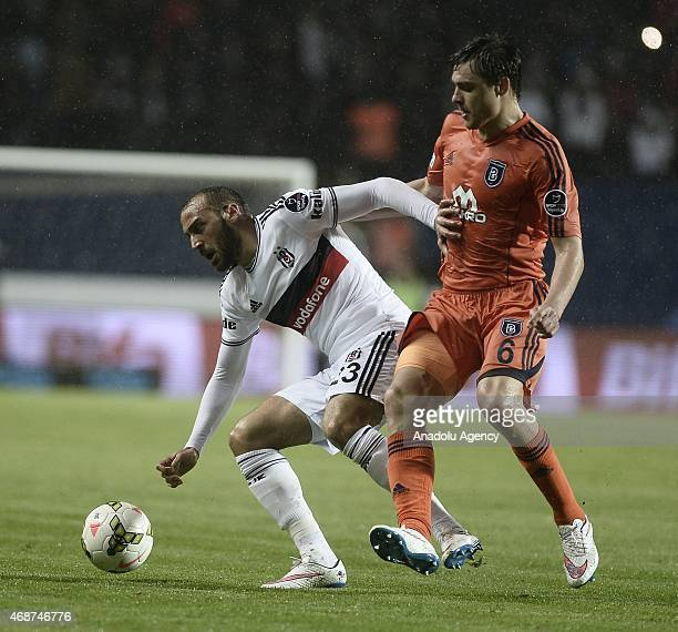 Cenk Tosun of Besiktas in action against Alexandru Epureanu of Istanbul Basaksehir during Turkish Spor Toto Super League football match between...