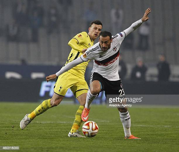 Cenk Tosun of Besiktas in action with Vlad Chirichesi of Tottenham Hotspur during the UEFA Europa League Group C match between Besiktas JK and...