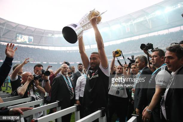 Cenk Tosun of Besiktas poses for a photo with trophy during the Besiktas' Turkish Super Lig title trophy ceremony at the Vodafone Park in Istanbul...