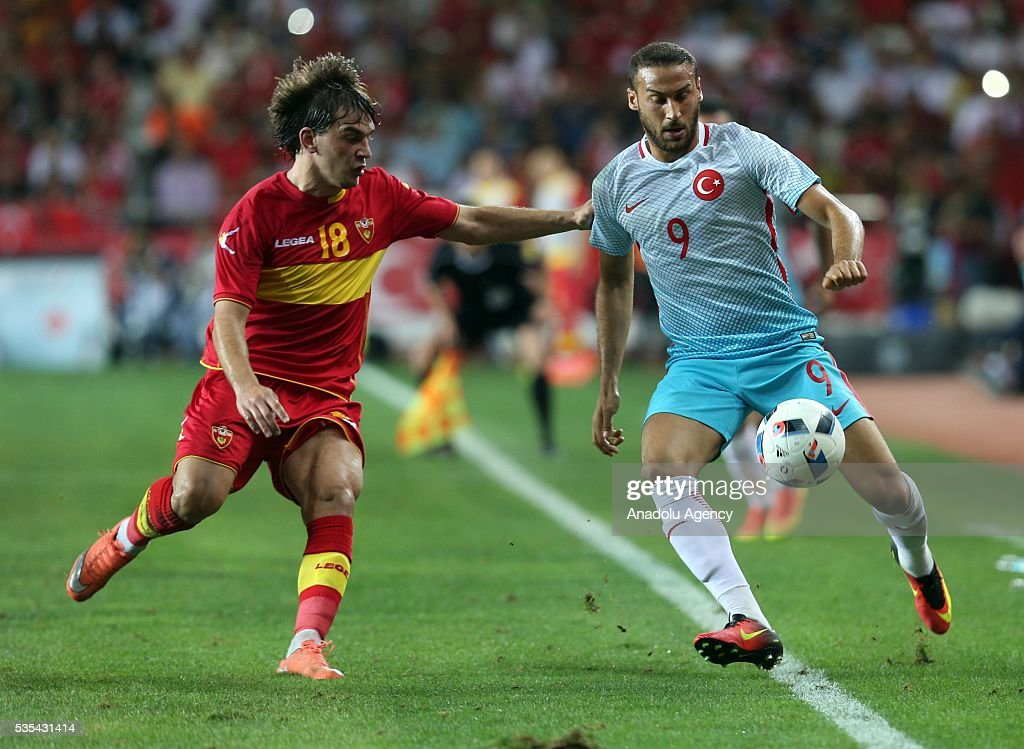 Cenk Tosun (R) of Turkey and and Stojkovic (L) of Montenegro vie for the ball during the friendly football match between Turkey and Montenegro at Antalya Ataturk Stadium in Antalya, Turkey on May 29, 2016.
