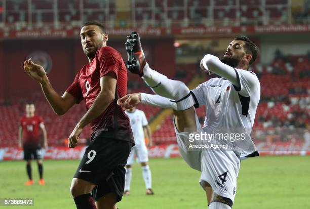 Cenk Tosun of Turkey in action against Elseid Hysaj of Albania during the Friendly match between Turkey and Albania at Antalya Stadium on November 13...
