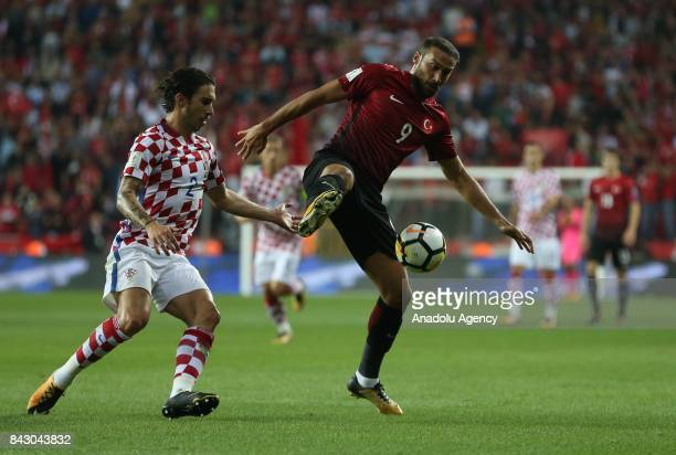 Cenk Tosun of Turkey in action against Vrsaljko of Belgium during the 2018 FIFA World Cup qualification Group I match between Turkey and Croatia at...