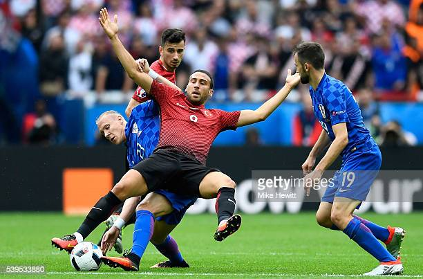 Cenk Tosun of Turkey is challenged by Domagoj Vida of Croatia during the UEFA EURO 2016 Group D match between Turkey and Croatia at Parc des Princes...