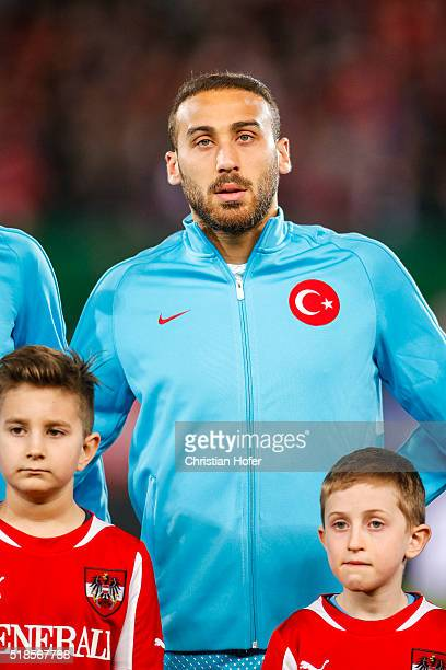 Cenk Tosun of Turkey lines up during the national anthem prior to the international friendly match between Austria and Turkey at ErnstHappelStadium...