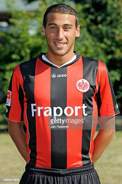 Cenk Tosun poses during the Eintracht Frankfurt team presentation at Frankfurt am Main airport on July 20 2010 in Frankfurt am Main Germany