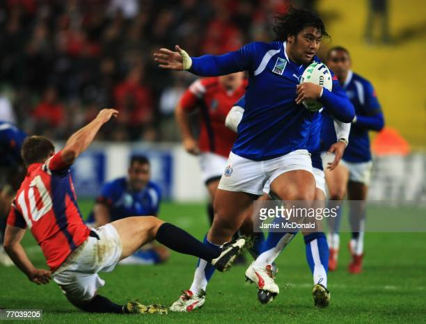 6 Census Johnston of Samoa brushes of the tackle form Mike Hercus of USA during match thirty two of the Rugby World Cup 2007 between Samoa and USA at...