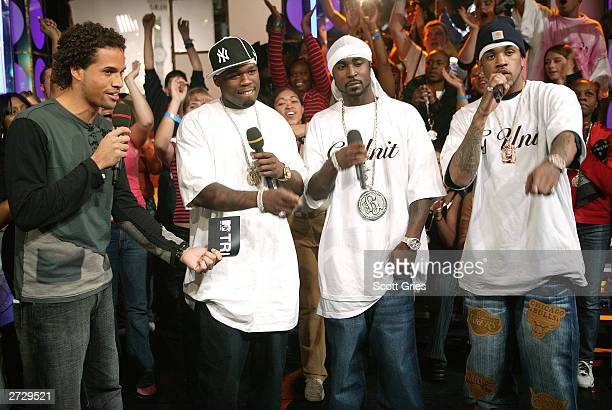 50 Cent and GUnit appear onstage with MTV VJ Quddus during 'Spankin' New Music Week' on MTV's Total Request Live at the MTV Times Square Studios...