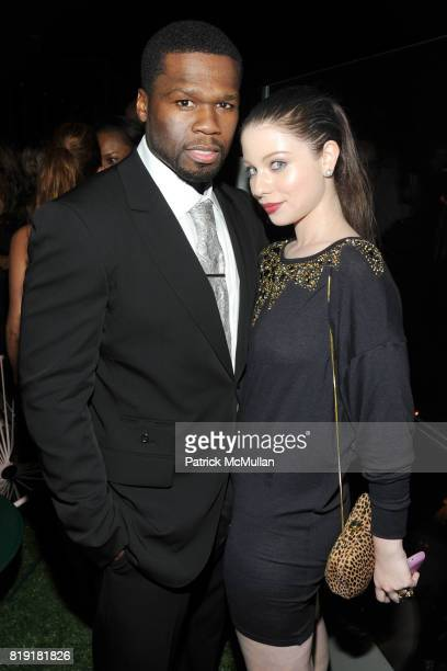Cent and Michelle Trachtenberg attend THE CINEMA SOCIETY 2IST host the after party for 'TWELVE' at at the Standard Hotel on July 28 2010 in New York...