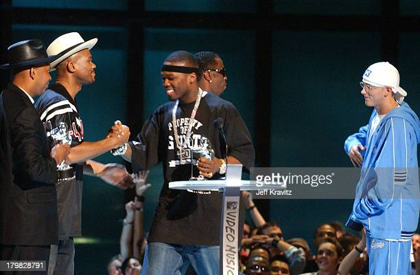 50 Cent center accepting award for Best New Artist In A Video at the 2003 MTV Video Music Awards Reverend Run DMC 50 Cent P Diddy and Eminem