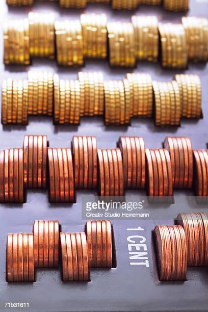 Stack of cent coins in cash box, close-up