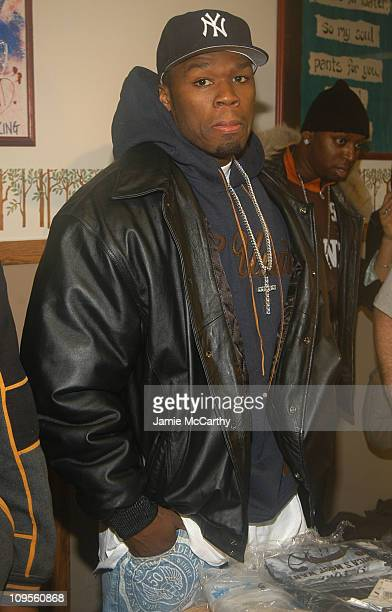 50 Cent during NY Jet Josh Evans and 50 Cent With GUnit Along With Glenn Toby and The Book Bank Foundation Build A One Day Superstore For The...