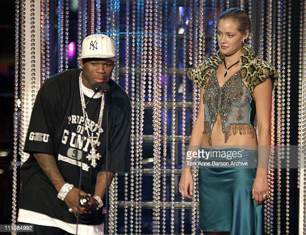 50 Cent receives the Award for 'World Best Artist 2003' from Kristanna Loken He received a total of 5 Awards