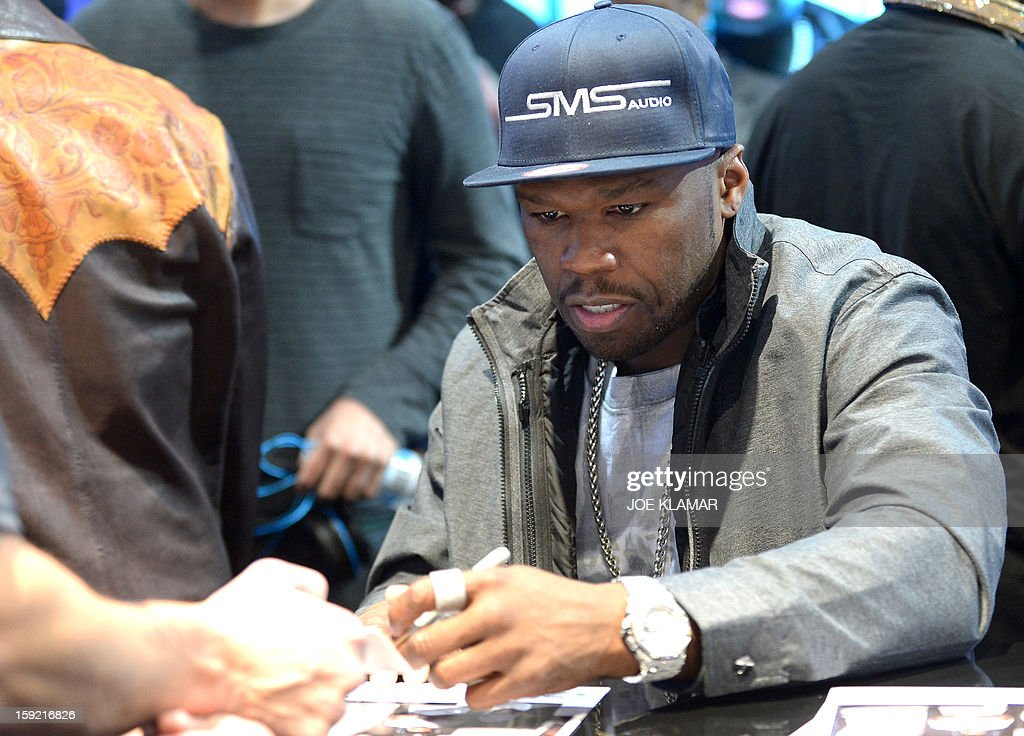 50 Cent signs autographs at SMS Audio booth at the Las Vegas Convention Center on January 9, 2013 in Las Vegas, Nevada. CES, the world's largest annual consumer technology trade show, runs from January 8-11 and is expected to feature 3,100 exhibitors showing off their latest products and services to about 150,000 attendees.AFP PHOTO / JOE KLAMAR