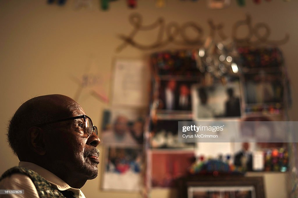 Centenarian George Gray Jr. turned 100 earlier this year. He was at his Park Hill home on Thursday, December 29, 2011. In the background are photos and cards celebrating his 100th birthday on the wall. Cyrus McCrimmon, The Denver Post