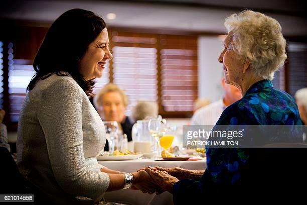 Centenarian Ludmilla Brassington talks with Queensland Premier Annastacia Palaszczuk at the Queensland Parliament in Brisbane on November 4 2016...