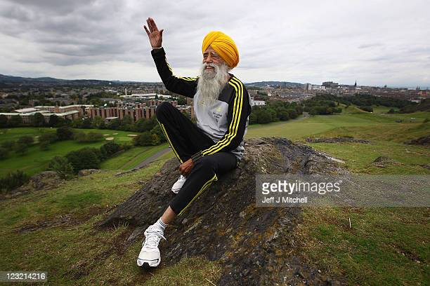 Centenarian Sikh runner Fauja Singh poses for pictures after being the first person to officially enter for next year's Edinburgh Marathon on...