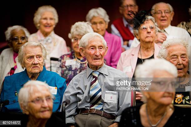 Centenarians pose for a group photograph with Queensland Premier Annastacia Palaszczuk at the Queensland Parliament in Brisbane on November 4 2016...