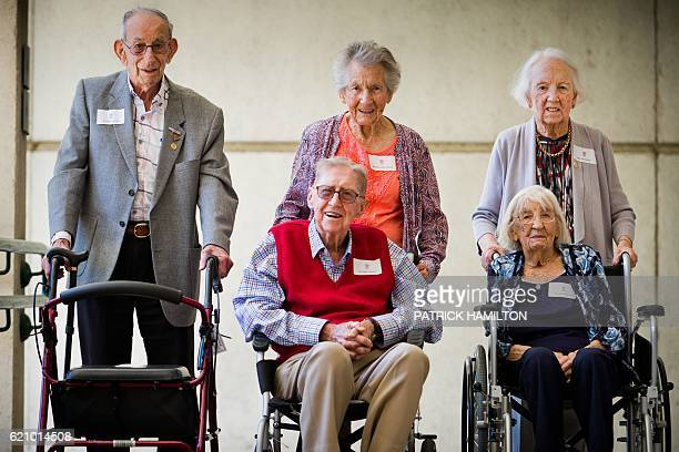 Centenarians Victor Lilienthal Maya Sonnenburg Joan Wilson Albert Lowcock and Isabel Paterson pose for a group photograph at the Queensland...