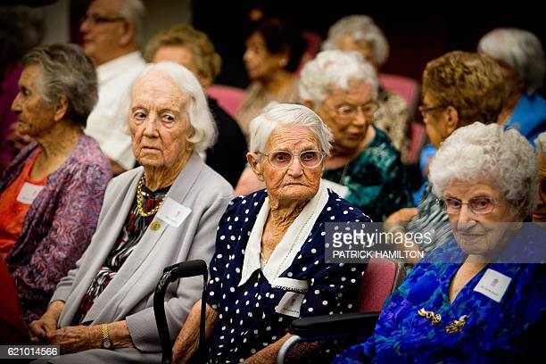 Centenarians wait for a group photograph with Queensland Premier Annastacia Palaszczuk at the Queensland Parliament in Brisbane on November 4 2016...