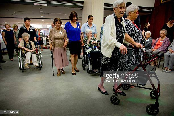 Centenarians walk to a group photograph with Queensland Premier Annastacia Palaszczuk at the Queensland Parliament in Brisbane on November 4 2016...