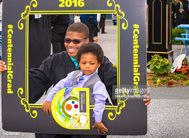 Centennial 2016 graduation celebration Loving family graduating brother taking picture with younger brother