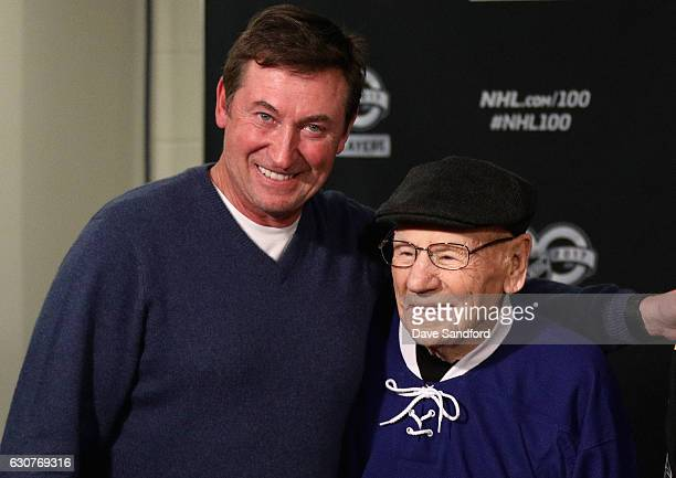 Centennial Ambassador Wayne Gretzky poses with Toronto Maple Leafs legend Johnny Bower after a press conference prior to the start of the 2017...