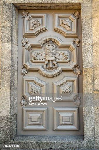 Centennial church door in porto portugal : Stock Photo