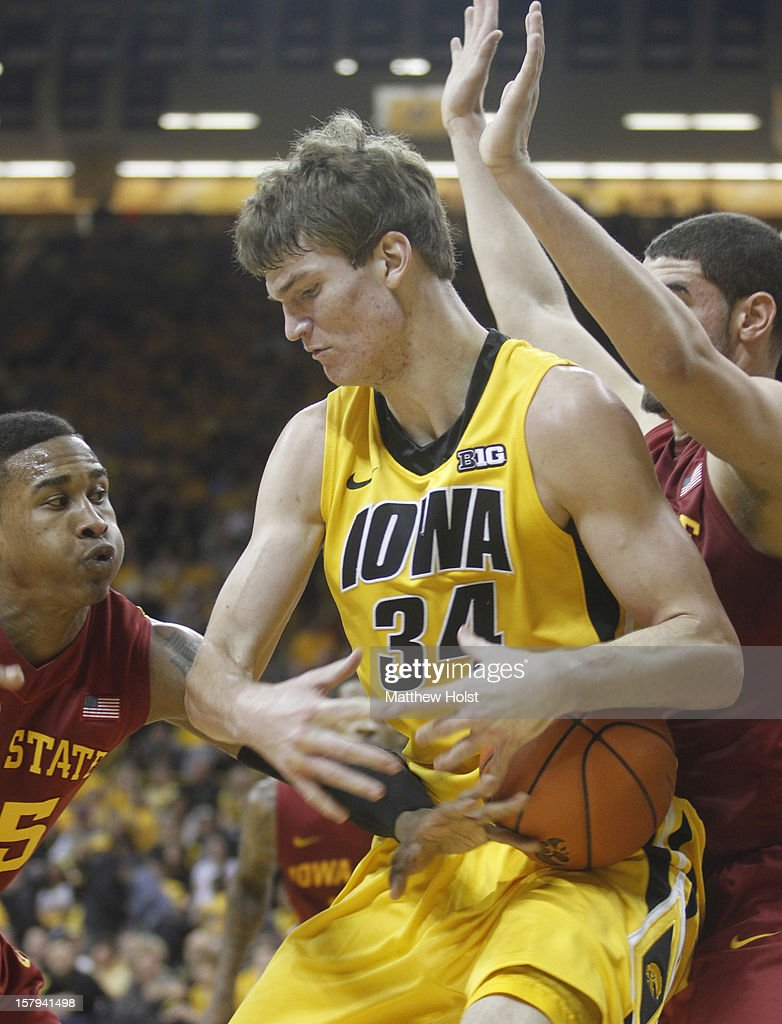 Center Adam Woodbury #34 of the Iowa Hawkeyes battles for a rebound during the first half against guard Tyrus McGee #25 of the Iowa State Cyclones on December 7, 2012 at Carver-Hawkeye Arena in Iowa City, Iowa. Iowa defeated Iowa State 80-71.