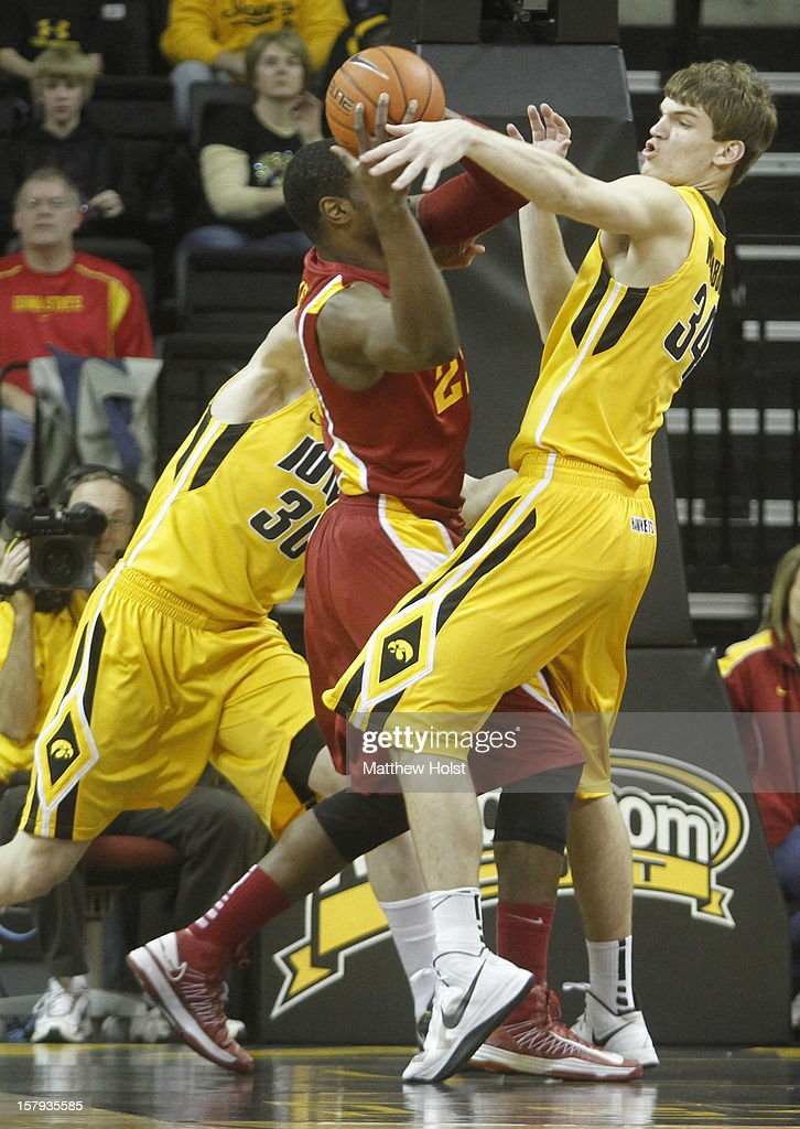 Center Adam Woodbury #32 of the Iowa Hawkeyes defends during the first half against forward Anthony Booker #22 of the Iowa State Cyclones on December 7, 2012 at Carver-Hawkeye Arena in Iowa City, Iowa. Iowa State led Iowa at the half 36-35.