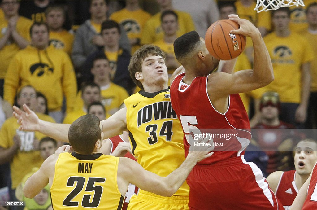 Center Adam Woodbury #34 of the Iowa Hawkeyes defends during the first half against guard Ryan Evans #5 of the Wisconsin Badgers on January 19, 2013 at Carver-Hawkeye Arena in Iowa City, Iowa. Iowa won 70-66.