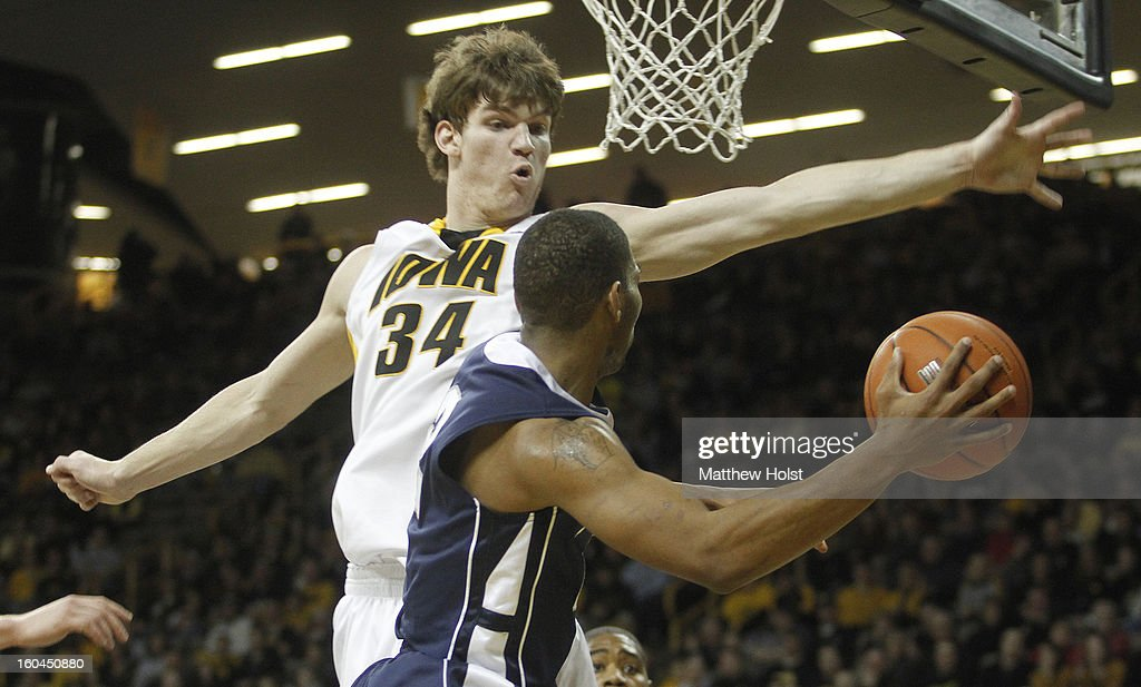 Center Adam Woodbury #34 of the Iowa Hawkeyes defends during the first half against guard D.J. Newbill #2 of the Penn State Nittany Lions on January 31, 2013 at Carver-Hawkeye Arena in Iowa City, Iowa.