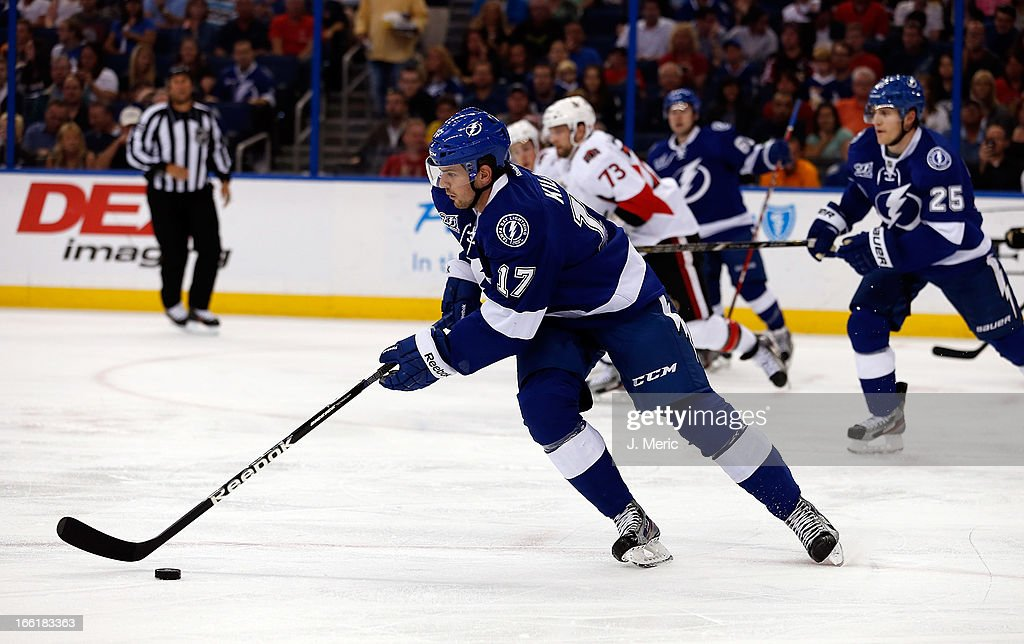 Center Alex Killorn #17 of the Tampa Bay Lightning advances the puck against the Ottawa Senators during the game at the Tampa Bay Times Forum on April 9, 2013 in Tampa, Florida.