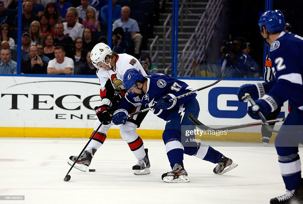Center Alex Killorn #17 of the Tampa Bay Lightning battles center <a gi-track='captionPersonalityLinkClicked' href=/galleries/search?phrase=Kyle+Turris&family=editorial&specificpeople=4251834 ng-click='$event.stopPropagation()'>Kyle Turris</a> #7 of the Ottawa Senators for the puck during the game at the Tampa Bay Times Forum on April 9, 2013 in Tampa, Florida.