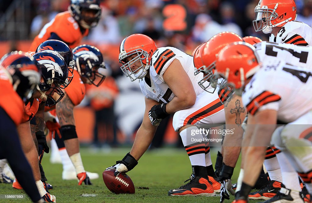 Center Alex Mack #55 of the Cleveland Browns prepares to snap the ball to quarterback Brandon Weeden #3 of the Cleveland Browns against the Denver Broncos at Sports Authority Field at Mile High on December 23, 2012 in Denver, Colorado. The Broncos defeated the Browns 34-12.